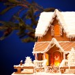 Gingerbread house over christmas background — Stock Photo