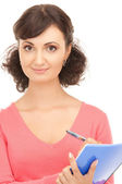 Young attractive businesswoman with notebook — Stock Photo