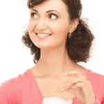 Woman holding energy saving bulb — Stock Photo