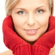 Beautiful woman in red mittens — Stock Photo #4280337