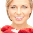 Beautiful woman in red mittens with snow — Stock Photo #4280347