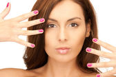 Lovely woman with polished nails — Stock Photo
