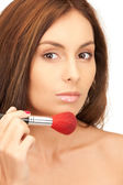 Lovely woman with brush — Stock Photo