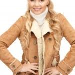 Beautiful woman in sheepskin jacket — Stock Photo #4328635
