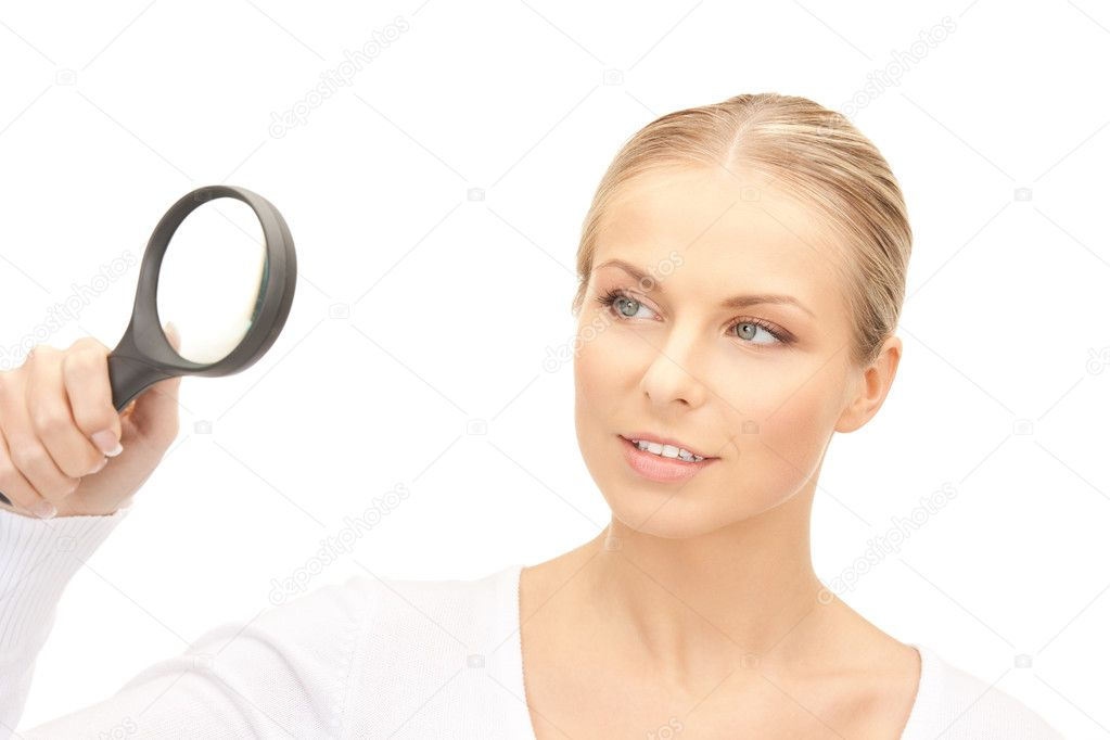 Picture of woman with magnifying glass over white — Stock Photo #4326559