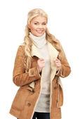 Beautiful woman in sheepskin jacket — Stock Photo