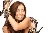 Lovely woman with leopard shoes — Stock Photo