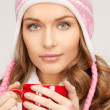 Beautiful woman with red mug - Stockfoto
