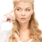 Pensive businesswoman over white — Stock Photo #4417543