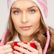 Beautiful woman with red mug — Stock Photo #4417647