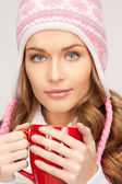 Beautiful woman with red mug — Stock Photo
