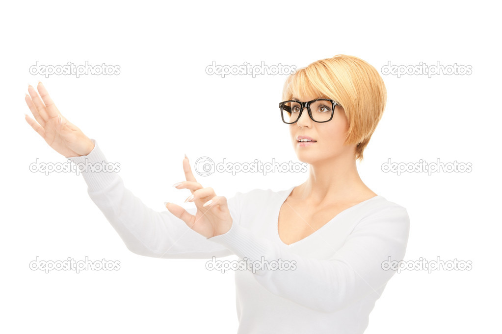 Picture of businesswoman working with something imaginary — Stock Photo #4427485