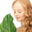 Woman with green leaf — Stock Photo #4432860