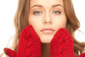 Beautiful woman in red mittens — Stock Photo