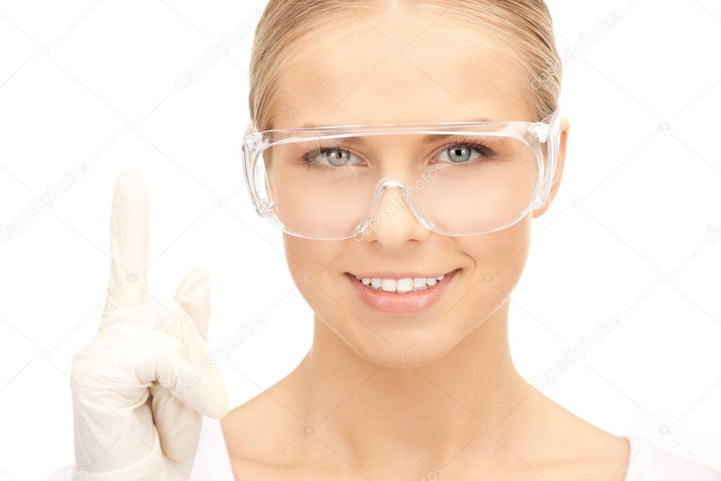 Bright picture of woman in protective glasses and gloves — Stock Photo #4432736