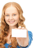 Happy woman with business card — Stock Photo