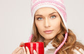 Beautiful woman with red mug — Stock Photo