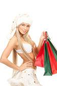 Wesoły pomocnik santa z torby na zakupy — Zdjęcie stockowe