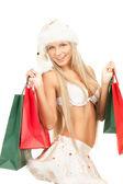 Veselý santa pomocník s nákupní tašky — Stock fotografie