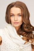 Beautiful woman in white comforter — Stock Photo
