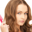 Beautiful woman with comb — Stock Photo #4492337