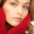 Beautiful woman in red mittens — Stock Photo #4492338