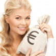 Woman with euro signed bag — Stock Photo