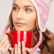 Beautiful woman with red mug — Stockfoto