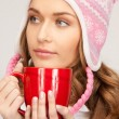 Beautiful woman with red mug - Stock Photo