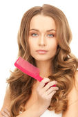 Beautiful woman with comb — Stock Photo