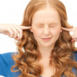 Woman with fingers in ears — Stock Photo #4952401