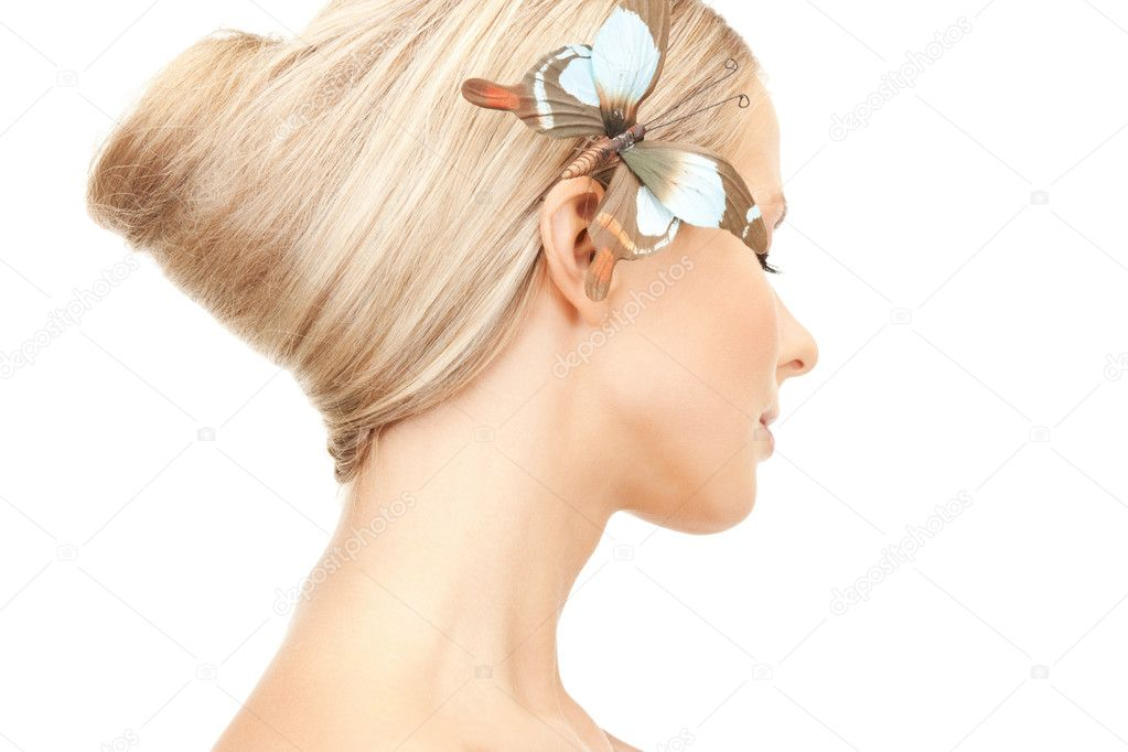Picture of beautiful woman with butterfly in hair — Stock Photo #5001170