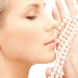 Beautiful woman with pearl beads — Stock Photo #5023283