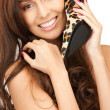Lovely woman with leopard shoes - Stockfoto
