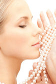 Beautiful woman with pearl beads — Stock Photo