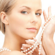 Beautiful woman with pearl beads — Stock Photo #5030241