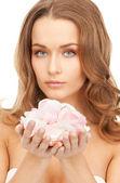 Beautiful woman with rose petals — Stock Photo