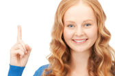 Woman with her finger up — Stock Photo