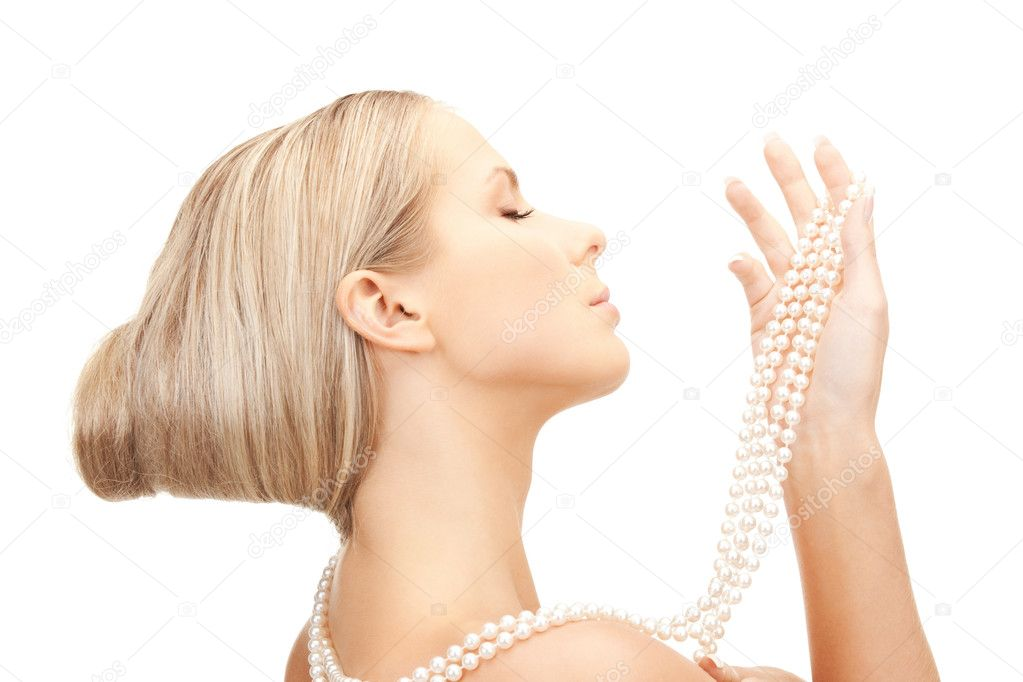 Picture of beautiful woman with pearl beads — Stock Photo #5048057