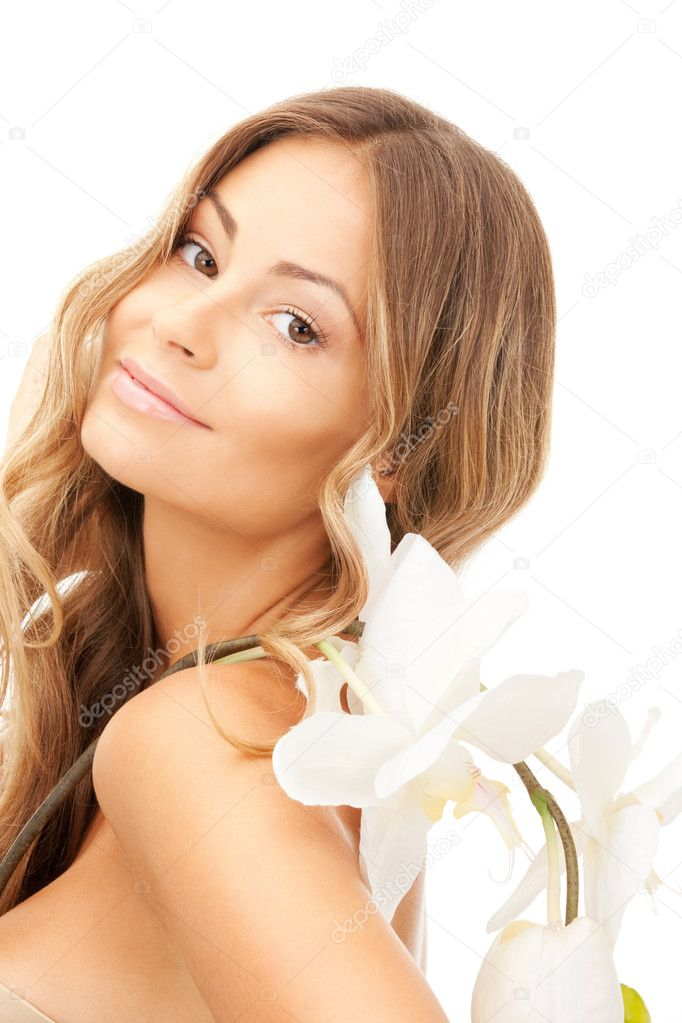 Picture of beautiful woman with orchid flower — Stok fotoğraf #5100328