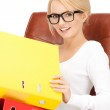 Young businesswoman with folders sitting in chair — Stock Photo #5126758