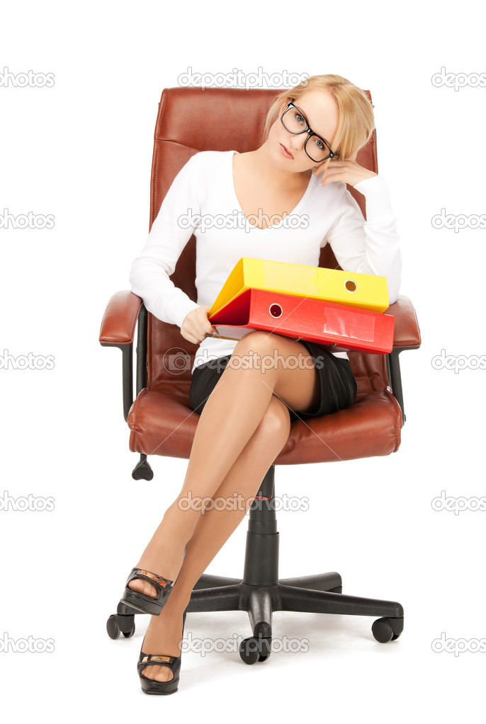 Picture of young businesswoman with folders sitting in chair  — Stock Photo #5126753