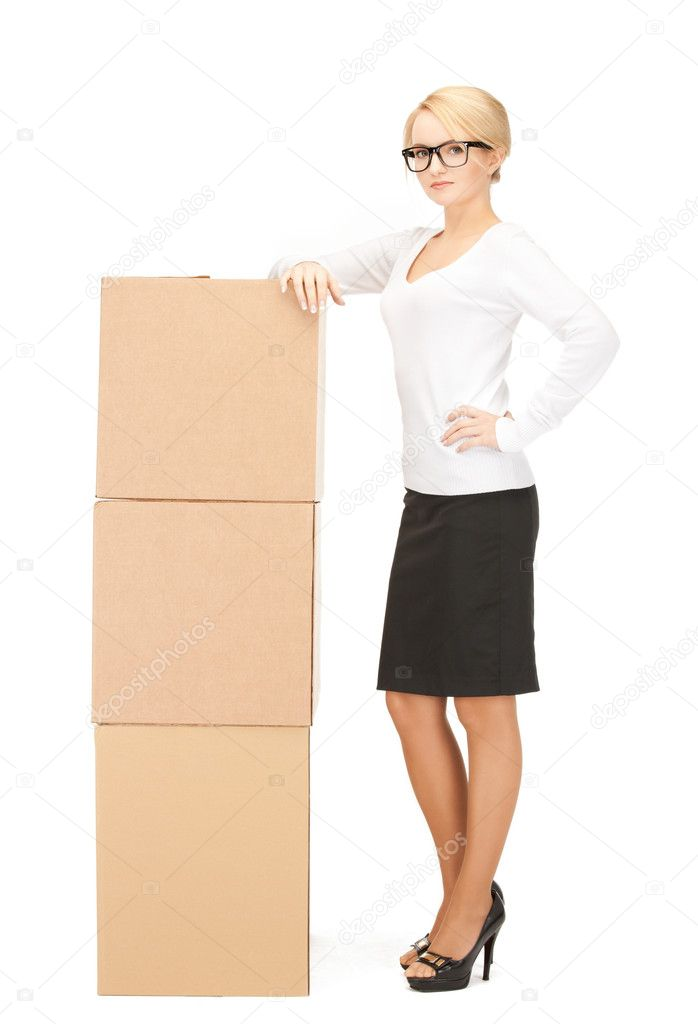Picture of attractive businesswoman with big boxes	  — Stock Photo #5126754
