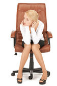 Young businesswoman sitting in chair — Stock Photo
