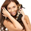 Lovely woman with leopard shoes — Stockfoto