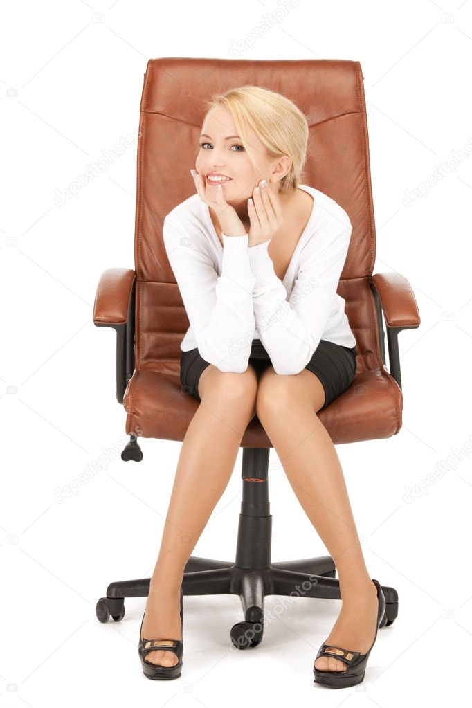 Picture of young businesswoman sitting in chair	   Stock Photo #5180716