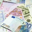 Dollar and euro banknotes — Stock Photo #3324707