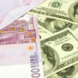 Dollar and euro banknotes — Stock Photo