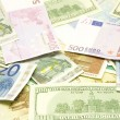 Dollar, euro, lat banknotes — Stock Photo #3324724