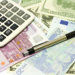 Dollar, euro banknotes, calculator, pen — Stock Photo